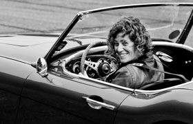 Woman driver with a big grin in an Austin Healey