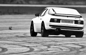 A Porsche 944 with a lot of weight on one side