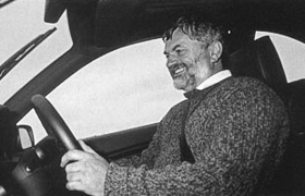 Don grinning at the wheel of a BMW